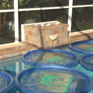 This owner has the right idea with the pool rings to retain heat, but the water feature is working against the heater.