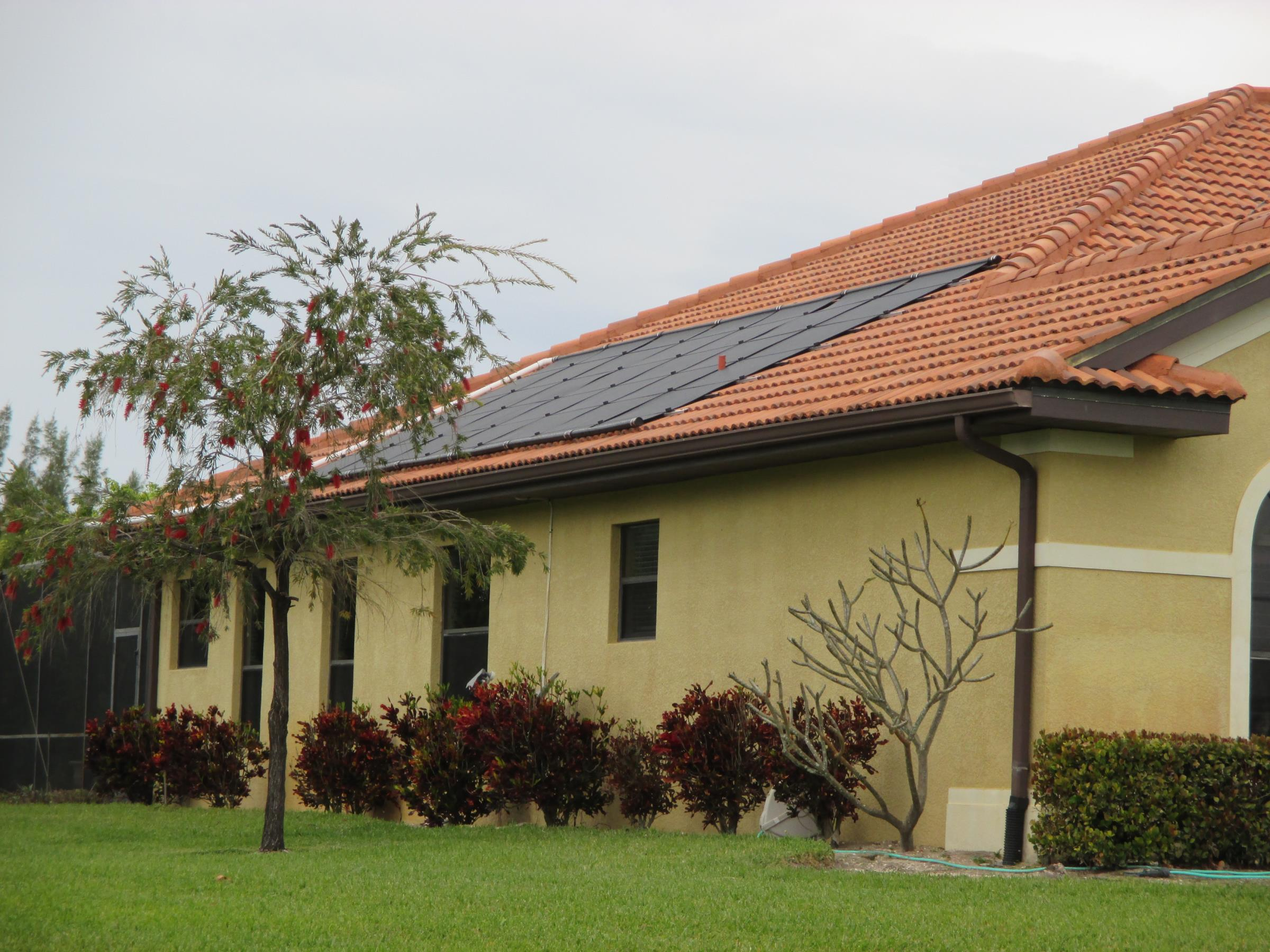 Solar Pool Heating Panels Installed on a Tile Roof