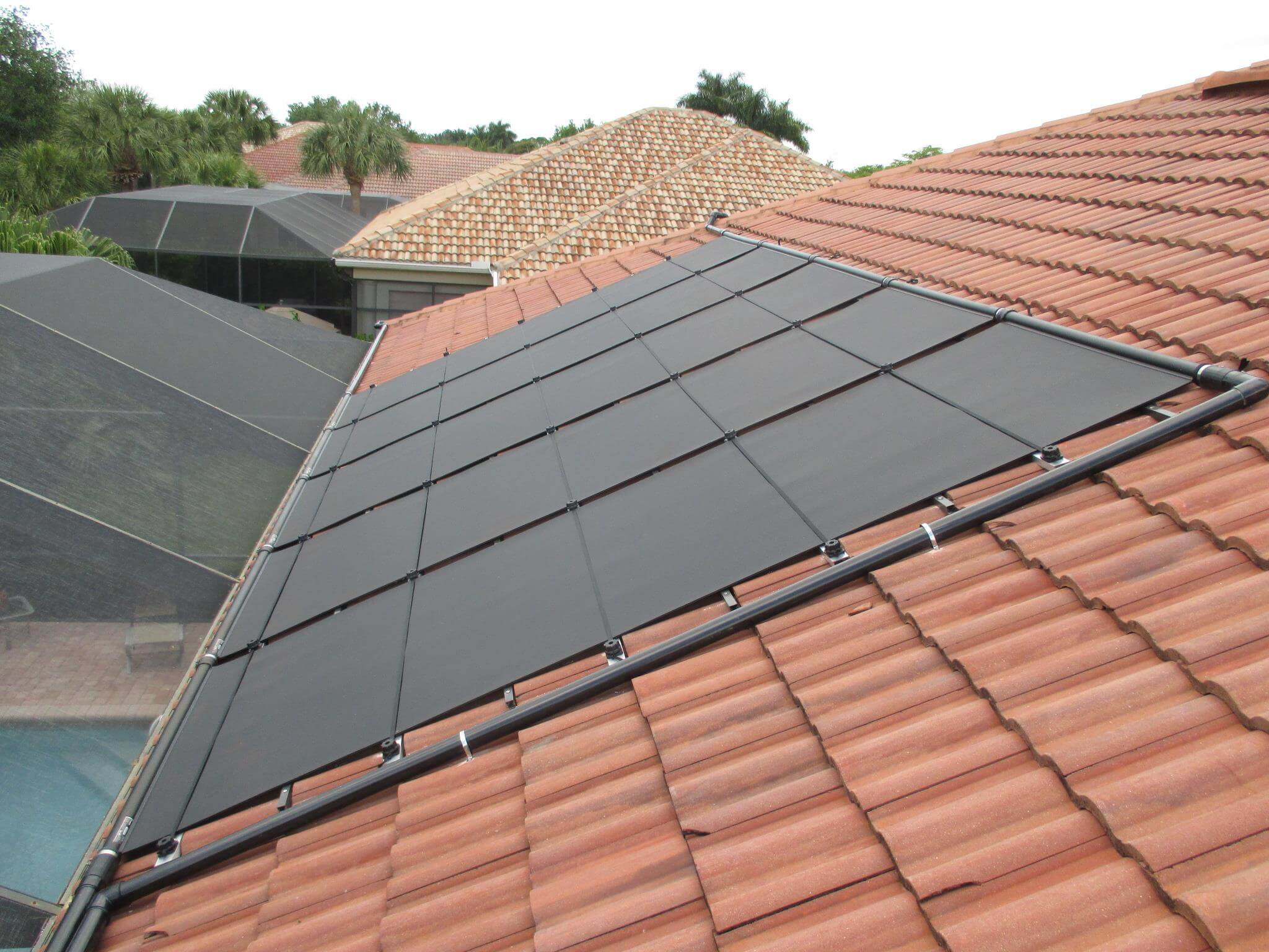 Five of the Eight Solar Pool Heating Panels on a Bonita Springs Roof. Three are on the west side.
