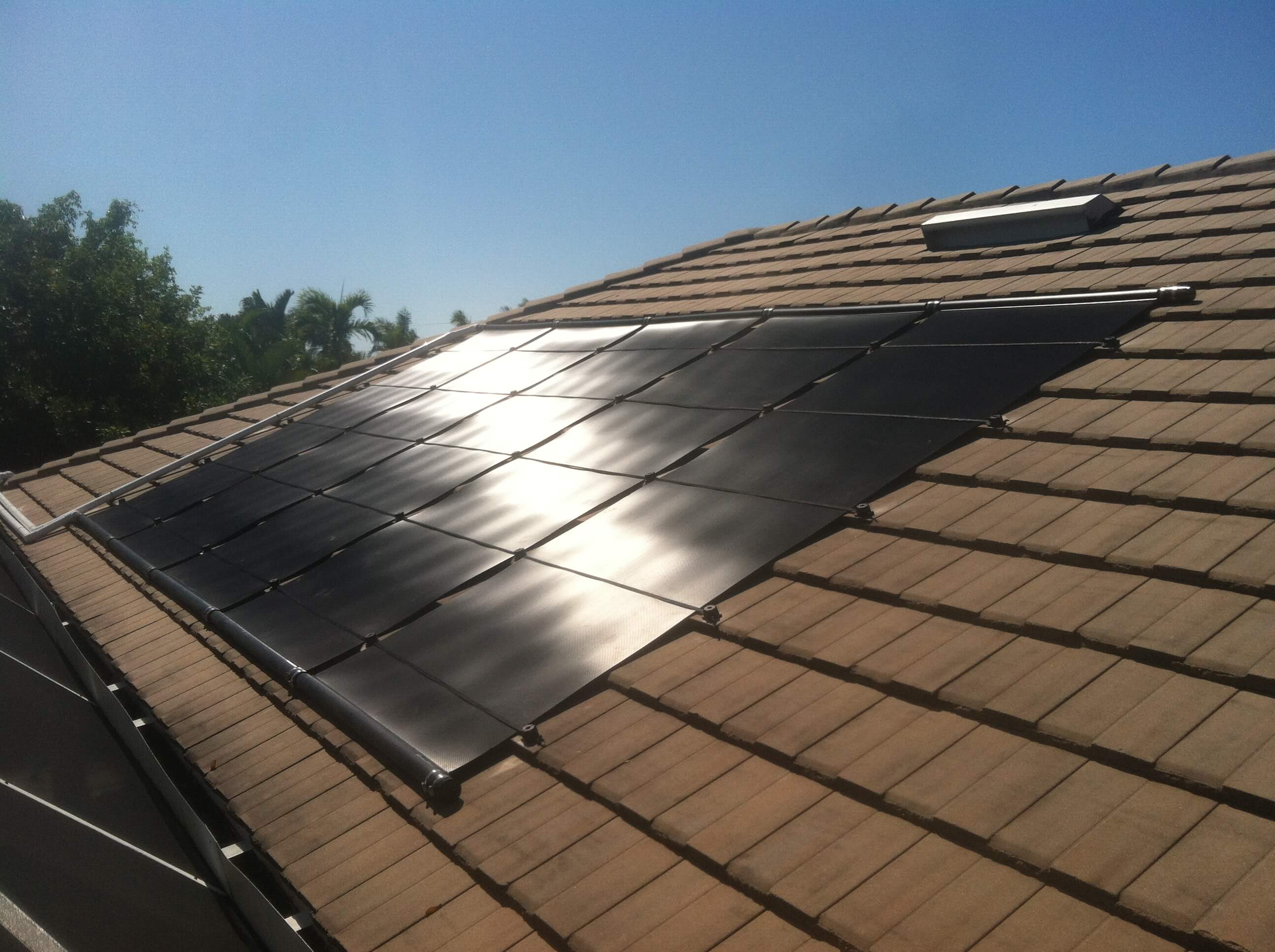 Solar Pool Heater on Flat Tile Roof in Cape Coral, FL