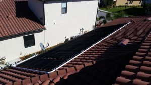 Solar Pool Heating Panels on a Tile Roof