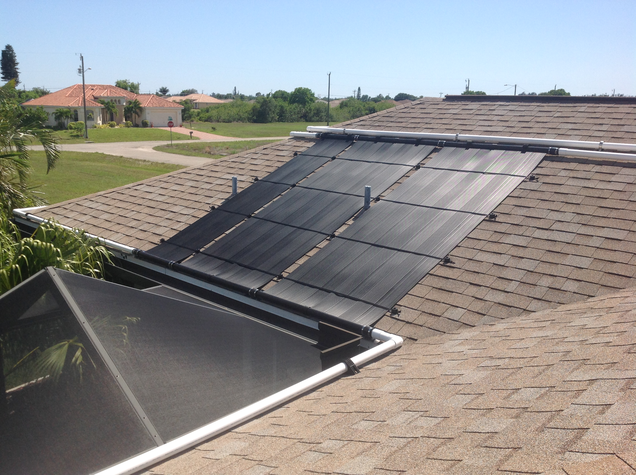A 2 Foot Wide Solar Pool Heating Collector Helps Fit Panels Between Two Roof  Vents.
