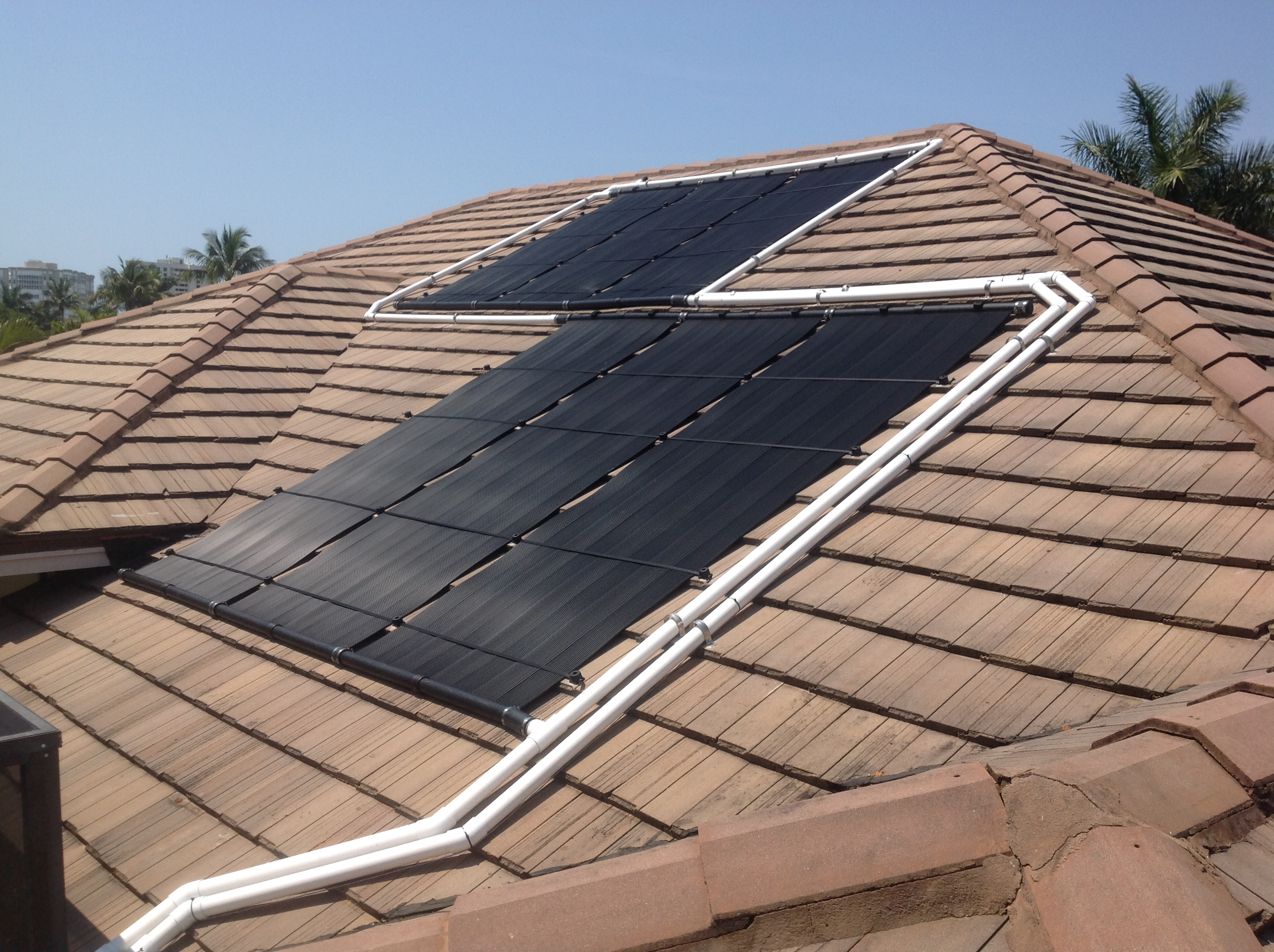 Naples Flat Tile Roof Gets Solar Pool Heater